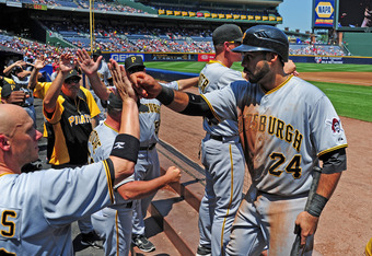 ATLANTA, GA - APRIL 29: Pedro Alvarez #24 of the Pittsburgh Pirates is congratulated by teammates after scoring a second inning run against the Atlanta Braves at Turner Field on April 29, 2012 in Atlanta, Georgia. (Photo by Scott Cunningham/Getty Images)