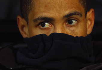 WATFORD, ENGLAND - JANUARY 27: Steven Pienaar of Spurs keeps warm on the bench during the FA Cup Fourth Round match between Watford and Tottenham Hotspur at Vicarage Road on January 27, 2012 in Watford, England.  (Photo by Richard Heathcote/Getty Images)