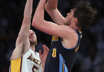LOS ANGELES, CA - APRIL 29:  Danilo Gallinari #8 of the Denver Nuggets shoots over Steve Blake #5 of the Los Angeles Lakers during the first half in Game One of the Western Conference Quarterfinals in the 2012 NBA Playoffs on April 29, 2012 at Staples Cen