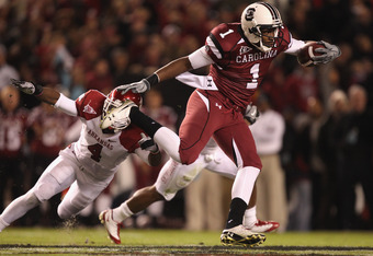 COLUMBIA, SC - NOVEMBER 06:  Teammates Rudell Crim #4 and Ramon Brown #26 of the Arkansas Razorbacks try to stop Alshon Jeffery #1 of the South Carolina Gamecocks during their game at Williams-Brice Stadium on November 6, 2010 in Columbia, South Carolina.