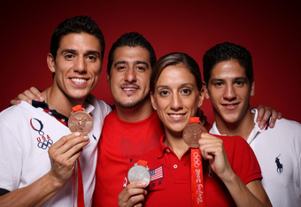 BEIJING - AUGUST 23:  (L-R) Taekwondo athletes Steven Lopez, Jean Lopez, Diana Lopez and Mark Lopez of the United States pose in the NBC Today Show Studio at the Beijing 2008 Olympic Games on August 23, 2008 in Beijing, China.  (Photo by Kristian Dowling/