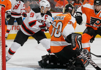 PHILADELPHIA, PA - APRIL 29:  Ilya Bryzgalov #30 and Kimmo Timonen #44 of the Philadelphia Flyers stop a scoring chance from Zach Parise #9 of the New Jersey Devils in Game One of the Eastern Conference Semifinals during the 2012 NHL Stanley Cup Playoffs