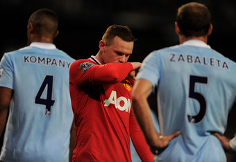 MANCHESTER, ENGLAND - APRIL 30:  Wayne Rooney of Manchester United looks dejected during the Barclays Premier League match between Manchester City and Manchester United at the Etihad Stadium on April 30, 2012 in Manchester, England.  (Photo by Michael Reg