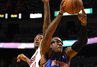 MIAMI, FL - APRIL 28:  Forward Amar'e Stoudemire #1 (R) of the New York Knicks shoots over Forward Udonis Haslem #40 of the Miami Heat in Game One of the Eastern  Conference Quarterfinals in the 2012 NBA Playoffs  on April 28, 2012 at the American Airines