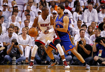 MIAMI, FL - APRIL 30: Dwyane Wade #3 of the Miami Heat posts up Landry Fields #2 of the New York Knicks during Game Two of the Eastern Conference Quarterfinals in the 2012 NBA Playoffs  at American Airlines Arena on April 30, 2012 in Miami, Florida. NOTE