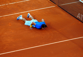 MADRID, SPAIN - MAY 16:  Rafael Nadal of Spain lays on court celebrating match point over Roger Federer of Switzerland in their final match during the Mutua Madrilena Madrid Open tennis tournament at the Caja Magica on May 16, 2010 in Madrid, Spain.  (Pho