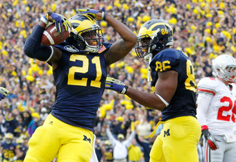 ANN ARBOR, MI - NOVEMBER 26: Junior Hemingway #21 of the Michigan Wolverines celebrates his first quarter touchdown with Kevin Koger #86 while playing the Ohio State Buckeyes at Michigan Stadium on November 26, 2011 in Ann Arbor, Michigan. (Photo by Grego