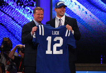 NEW YORK, NY - APRIL 26:  Andrew Luck (R) from Stanford holds up a jersey as he stands on stage with NFL Commissioner Roger Goodell after Luck was selected #1 overall by the Indianapolis Colts in the first round of the 2012 NFL Draft at Radio City Music H