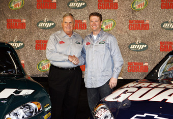 DALLAS, TX - SEPTEMBER 19:  Dale Earnhardt Jr. (R) of the Hendrick Motorsports Racing Team poses with Rick Hendrick and his new cars on September 19, 2007 at the Dallas Convention Center in Dallas, Texas.  (Photo by Layne Murdoch/Getty Images)