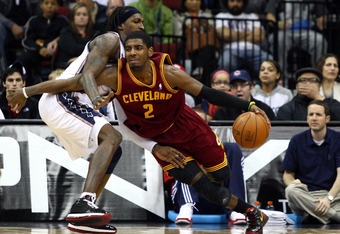 NEWARK, NJ - MARCH 19:  Kyrie Irving #2 of the Cleveland Cavaliers drives in the second half against Gerald Wallace #45 of the New Jersey Nets at Prudential Center on March 19, 2012 in Newark, New Jersey.  NOTE TO USER: User expressly acknowledges and agr