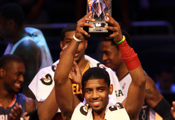 ORLANDO, FL - FEBRUARY 24:  Kyrie Irving #2 of the Cleveland Cavaliers and Team Chuck holds up his MVP award during the BBVA Rising Stars Challenge part of the 2012 NBA All-Star Weekend at Amway Center on February 24, 2012 in Orlando, Florida.  NOTE TO US