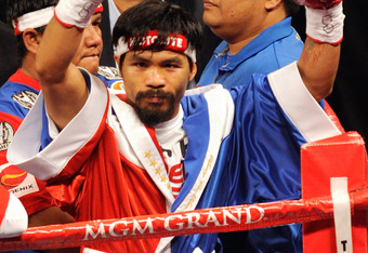 LAS VEGAS, NV - NOVEMBER 12:  Boxer Manny Pacquiao appears in the ring before his WBO world welterweight title fight against Juan Manuel Marquez at the MGM Grand Garden Arena November 12, 2011 in Las Vegas, Nevada. Pacquiao retained his title with a major