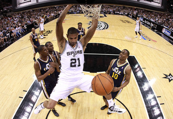 SAN ANTONIO, TX - APRIL 29:  Tim Duncan #21 of the San Antonio Spurs gets a slam dunk against the Utah Jazz in Game One of the Western Conference Quarterfinals in the 2012 NBA Playoffs at AT&T Center on April 29, 2012 in San Antonio, Texas.  NOTE TO USER: