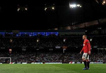 MANCHESTER, ENGLAND - APRIL 30:  Wayne Rooney of Manchester United looks on during the Barclays Premier League match between Manchester City and Manchester United at the Etihad Stadium on April 30, 2012 in Manchester, England.  (Photo by Michael Regan/Get