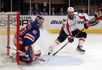 NEW YORK, NY - APRIL 30:  Mike Knuble #22 of the Washington Capitals sets up in front of the net in the first period against goalie Henrik Lundqvist #30 of the New York Rangers in Game Two of the Eastern Conference Semifinals during the 2012 NHL Stanley C