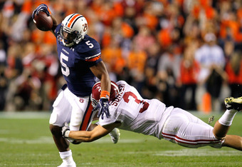 AUBURN, AL - NOVEMBER 26:  Michael Dyer #5 of the Auburn Tigers is tackled by Vinnie Sunseri #3 of the Alabama Crimson Tide at Jordan-Hare Stadium on November 26, 2011 in Auburn, Alabama.  (Photo by Kevin C. Cox/Getty Images)