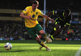 NORWICH, ENGLAND - MARCH 11:  Grant Holt of Norwich City battles with Maynor Figueroa of Wigan Athletic during the Barclays Premier League match between Norwich City and Wigan Athletic at Carrow Road on March 11, 2012 in Norwich, England.  (Photo by Jamie