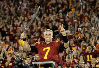 LOS ANGELES, CA - NOVEMBER 26:  Quarterback Matt Barkley #7 of the USC Trojans conducts the band after the game with the UCLA Bruins at the Los Angeles Memorial Coliseum on November 26, 2011 in Los Angeles, California. USC won 50-0.  (Photo by Stephen Dun