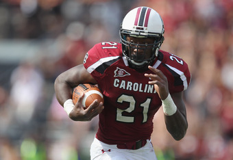 COLUMBIA, SC - OCTOBER 08:  Marcus Lattimore #21 of the South Carolina Gamecocks runs with the ball against the Kentucky Wildcats during their game at Williams-Brice Stadium on October 8, 2011 in Columbia, South Carolina.  (Photo by Streeter Lecka/Getty I