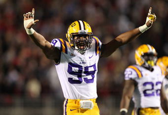 OXFORD, MS - NOVEMBER 19: Sam Montgomery #99 of the LSU Tigers celebrates a play against the Ole Miss Rebels on November 19, 2011 at Vaught-Hemingway Stadium in Oxford, Mississippi.  (Photo by Joe Murphy/Getty Images)
