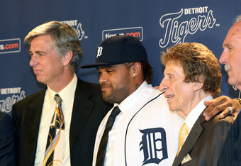 Prince Fielder (middle) being introduced as a Detroit Tiger by Tiger's President/GM Dave Dombrowski (left) and team owner Mike Ilitch (right)
