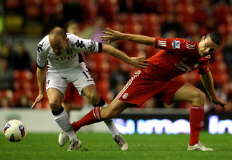 LIVERPOOL, ENGLAND - MAY 01:   Danny Murphy of Fulham competes with Andy Carroll of Liverpool during the Barclays Premier League match between Liverpool and Fulham at Anfield on May 1, 2012 in Liverpool, England. (Photo by Clive Brunskill/Getty Images)