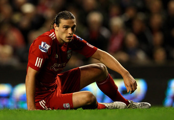 LIVERPOOL, ENGLAND - MAY 01:  Andy Carroll of Liverpool reacts to a missed chance during the Barclays Premier League match between Liverpool and Fulham at Anfield on May 1, 2012 in Liverpool, England.  (Photo by Clive Brunskill/Getty Images)