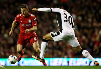 LIVERPOOL, ENGLAND - MAY 01:  Mousa Dembele of Fulham challenges Fabio Aurelio of Liverpool during the Barclays Premier League match between Liverpool and Fulham at Anfield on May 1, 2012 in Liverpool, England.  (Photo by Clive Brunskill/Getty Images)