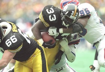 6 Jan 1996: Running back Bam Morris of the Pittsburgh Steelers scores a touchdown during a playoff game against the Buffalo Bills at Three Rivers Stadium in Pittsburgh, Pennsylvania. The Steelers won the game, 40-21.