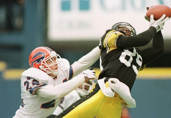 6 Jan 1996: Wide receiver Ernie Mills #89 of the Pittsburgh Steelers catches a pass over free safety Kurt Schulz #24 of the Buffalo Bills for a touchdown in the second quarter of the AFC playoff game at Three Rivers Stadium in Pittsburgh, Pennsylvania.