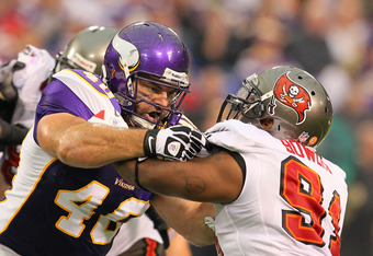 MINNEAPOLIS, MN - SEPTEMBER 18:     Jimmy Kleinsasser #40 of the Minnesota Vikings blocks Da'Quan Bowers #91 of the Tampa Bay Buccaneers at the Hubert H. Humphrey Metrodome on September 18, 2011 in Minneapolis, Minnesota.  (Photo by Adam Bettcher /Getty I