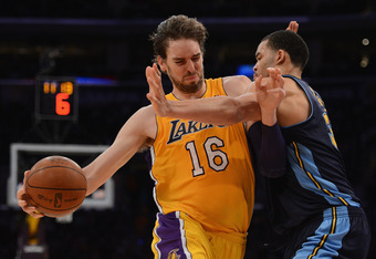 LOS ANGELES, CA - MAY 01:  Pau Gasol #16 of the Los Angeles Lakers is fouled as he drives on JaVale McGee #34 of the Denver Nuggets during Game Two of the Western Conference Quarterfinals in the 2012 NBA Playoffs at Staples Center on May 1, 2012 in Los An