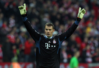 MUNICH, GERMANY - APRIL 03:  Manuel Neuer, goalkeeper of Muenchen celebrates after the UEFA Champions League quarter-final second leg match at Allianz Arena on April 3, 2012 in Munich, Germany.  (Photo by Martin Rose/Bongarts/Getty Images)