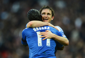 LONDON, ENGLAND - APRIL 15:  Frank Lampard of Chelsea celebrates with Didier Drogba as he scores their fourth goal from a free kick during the FA Cup with Budweiser Semi Final match between Tottenham Hotspur and Chelsea at Wembley Stadium on April 15, 201