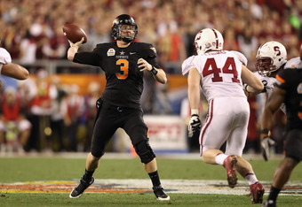 GLENDALE, AZ - JANUARY 02:  Brandon Weeden #3 of the Oklahoma State Cowboys throws a pass during the Tostitos Fiesta Bowl against the Stanford Cardinal on January 2, 2012 at University of Phoenix Stadium in Glendale, Arizona.  (Photo by Christian Petersen