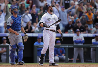 DENVER, CO - APRIL 29:  Todd Helton #17 of the Colorado Rockies watches his pinch hit grand slam home run, along with catcher Josh Thole #30 of the New York Mets, off of relief pitcher Tim Byrdak #40 of the New York Mets to tie the score 4-4 with two out