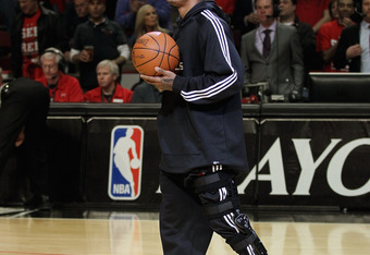 CHICAGO, IL - MAY 01: Derrick Rose #1 of the Chicago Bulls, injured in game one against the Philadelphia 76ers, walks onto the court to deliver the game ball before Game Two of the Eastern Conference Quarterfinals during the 2012 NBA Playoffs at the Unite