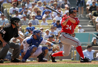 LOS ANGELES, CA - APRIL 29:  Bryce Harper #34 of the Washington Nationals hits a single in the seventh inning against the Los Angeles Dodgers on April 29, 2012 at Dodger Stadium in Los Angeles, California.  The Dodgers won 2-0.  (Photo by Stephen Dunn/Get