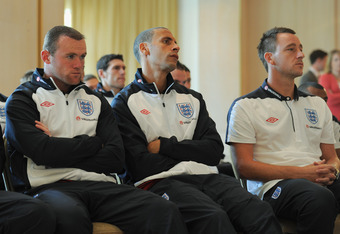 ST ALBANS, ENGLAND - AUGUST 09:  (L-R) Wayne Rooney, Rio Ferdinand and John Terry look on during the England press conference at The Grove Hotel on August 9, 2011 in Watford, England.  (Photo by Michael Regan/Getty Images)