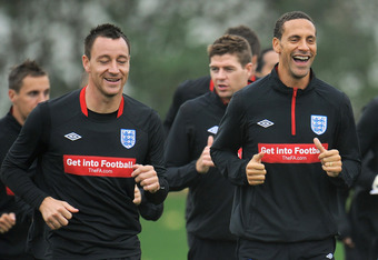 ST ALBANS, ENGLAND - OCTOBER 08:  John Terry, Rio Ferdinand and Steven Gerrard warm up during the England training session at London Colney on October 8, 2010 in St Albans, England.  (Photo by Michael Regan/Getty Images)
