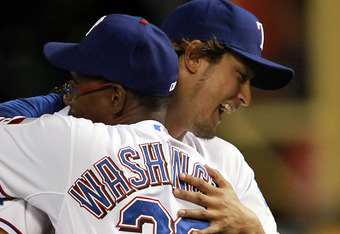 ARLINGTON, TX - APRIL 24:  Yu Darvish #11 of the Texas Rangers gets a hug from Ron Washington #38 after a 2-0 win against the New York Yankees at Rangers Ballpark in Arlington on April 24, 2012 in Arlington, Texas.  (Photo by Ronald Martinez/Getty Images)