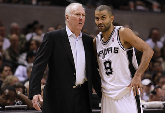 SAN ANTONIO, TX - APRIL 29:  (L-R) Gregg Popovich  and Tony Parker #9 of the San Antonio Spurs talk during play against the Utah Jazz in Game One of the Western Conference Quarterfinals in the 2012 NBA Playoffs at AT&T Center on April 29, 2012 in San Anto