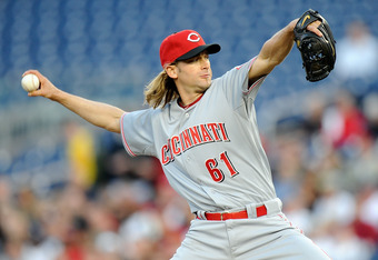 Official measurements haven't been made, but Bronson Arroyo is also among the league leaders in hair trailing from cap.