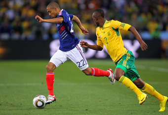 BLOEMFONTEIN, SOUTH AFRICA - JUNE 22: Siboniso Gaxa of South Africa pursues Gael Clichy of France during the 2010 FIFA World Cup South Africa Group A match between France and South Africa at the Free State Stadium on June 22, 2010 in Mangaung/Bloemfontein