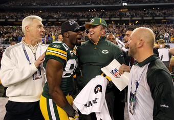 ARLINGTON, TX - FEBRUARY 06:  (L-R) General Manager Ted Thompson, Greg Jennings #85 and head coach Mike McCarthy of the Green Bay Packers celebrate their 31-25 win against the Pittsburgh Steelers during Super Bowl XLV at Cowboys Stadium on February 6, 201