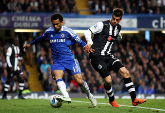 LONDON, ENGLAND - MAY 02:  Ramires of Chelsea holds off the challenge from Davide Santon of Newcastle during the Barclays Premier League match between Chelsea and Newcastle United at Stamford Bridge on May 2, 2012 in London, England.  (Photo by Julian Fin