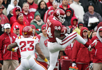 NORMAN, OK - NOVEMBER 26:  Wide receiver Dejuan Miller #24 of the Oklahoma Sooners pulls down a reception in front of cornerback Leonard Johnson #23 of the Iowa State Cyclones during the first half November 26, 2011 at Gaylord Family-Oklahoma Memorial Sta