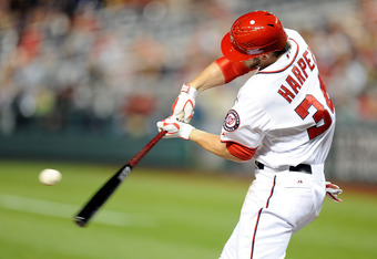 WASHINGTON, DC - MAY 02:  Bryce Harper #34 of the Washington Nationals hits a double in the fourth inning against the Arizona Diamondbacks at Nationals Park on May 2, 2012 in Washington, DC.  (Photo by Greg Fiume/Getty Images)