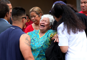 OCEANSIDE, CA - MAY 2:  Luisa Seau (C), the mother of Junior Seau who was found dead, is consoled with friends and family members at the former linebacker's beach home May 2, 2012 in Oceanside, California. Seau, who played for various NFL teams including