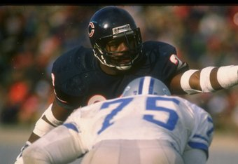 Defensive back Dave Duerson of the Chicago Bears works against the Detroit Lions during a game at Soldier Field in Chicago, Illinois.
